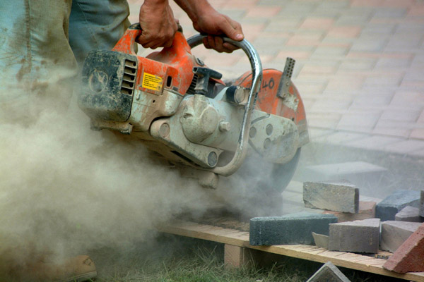 Cement Worker with Saw